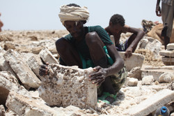 Afar, a man mining salt