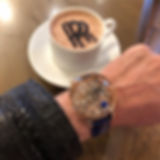 Luxury Jacob & Co Astronomia watch on Producer Michael Blakey's wrist with a cup of Rolls Royce coffee