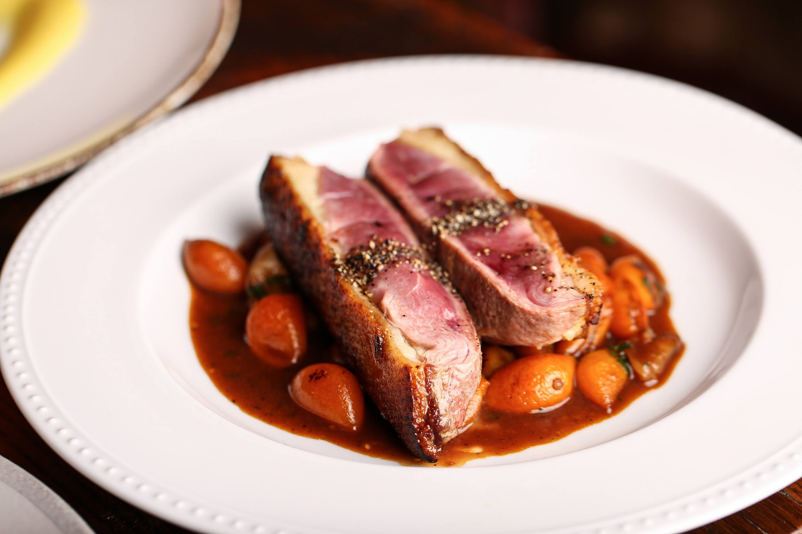 rohan duck breast with kumquat and duck demi