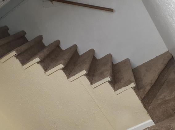 after basement stairs new carpet.jpg