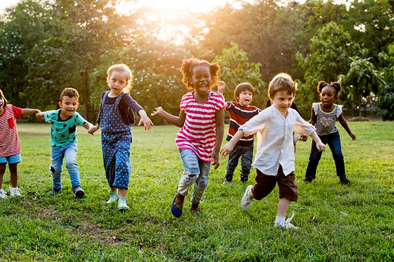 group-diverse-kids-playing-field-togethe