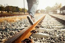 female-legs-sneakers-rail-railway_1421-2