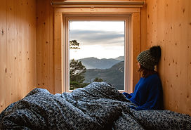 Adventure young girl in a wooden cabin g