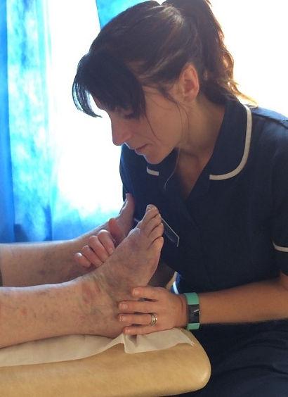 nurse performing diabetic foot check