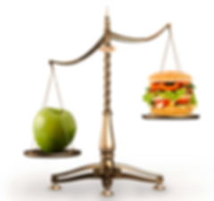 scales comparing weight of apple and burger.pn