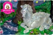 Modeling chocolate kelpie Fantastic Beasts cake