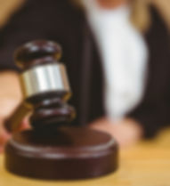 Hand-about-to-bang-gavel-on-sounding-blo