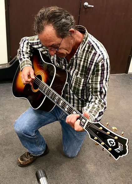 Guitar 48 owner playing a brand new Guild guitar at the factory in Oxnard, CA.