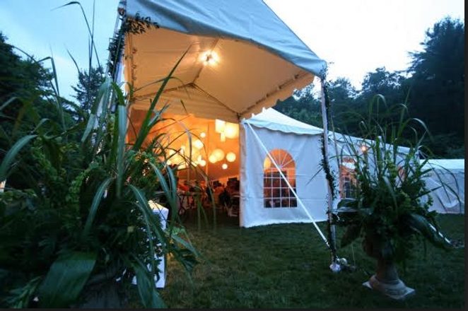 Marquee entrance, marquee tent entrance, tent entry way rent, rent marquee tent entrance, rent marquee, rent tent door, tent with chairs and tables rent, tent entrance set up with flowers, marquee tent entrance with lights for rent