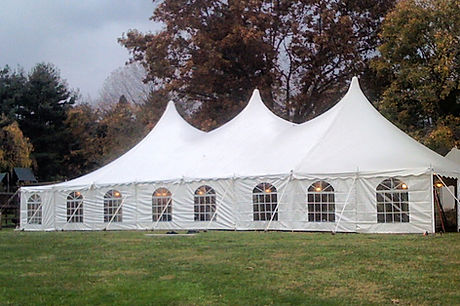 Outdoor event tent with sides, lights, dance floor, stage, seating, tables, pole tent for graduation/wedding party in Malvern pa