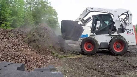 Bobcat dumping store for contractor job at home owners parking lot/yard, heavy equipment in action delivered to customer in malvern pa