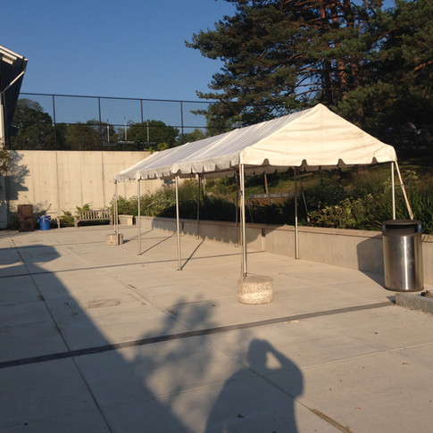 shade tent set up for check in tables