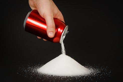 Unhealthy food concept - sugar in carbon