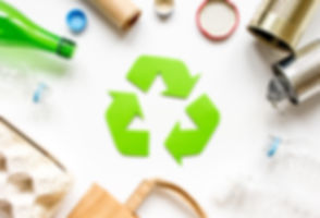 waste recycling symbol with garbage on w