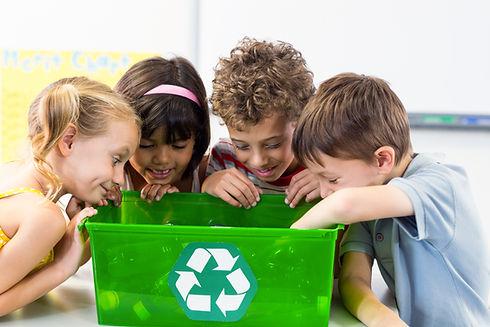 Cute children looking at plastic bottles