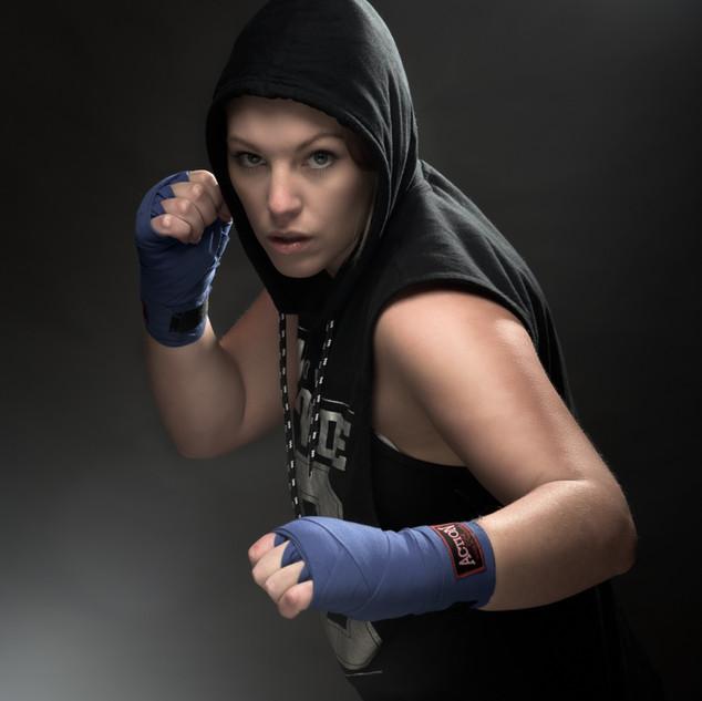 hooded female kickboxer