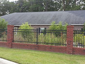 custom wrought iron fence with brick Cape Fear