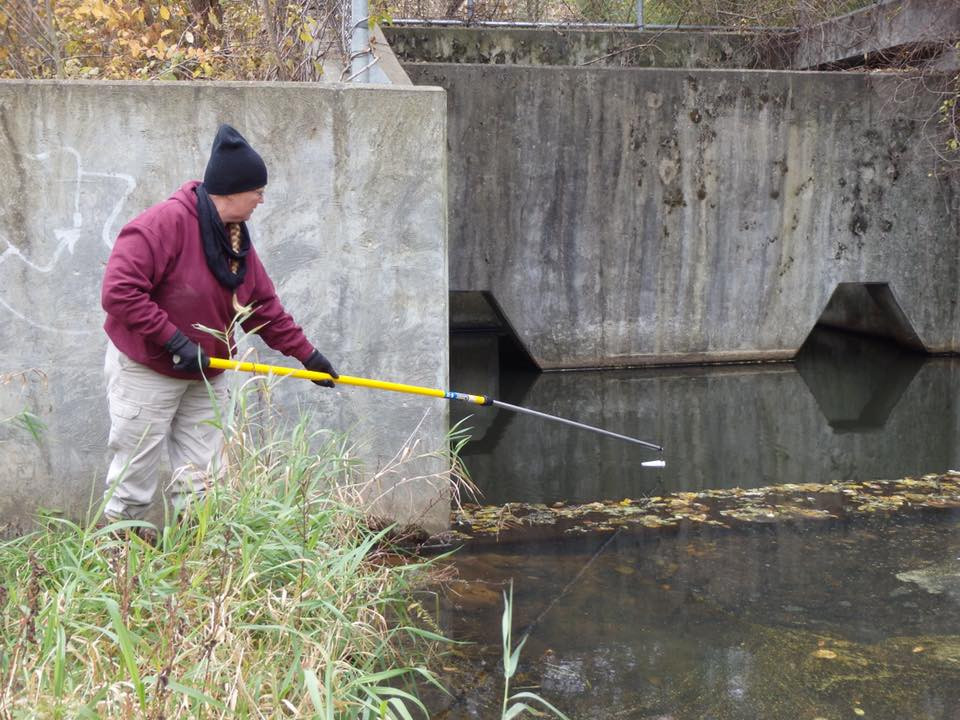 Janelle collecting water from an inlet at Lake Keomah.