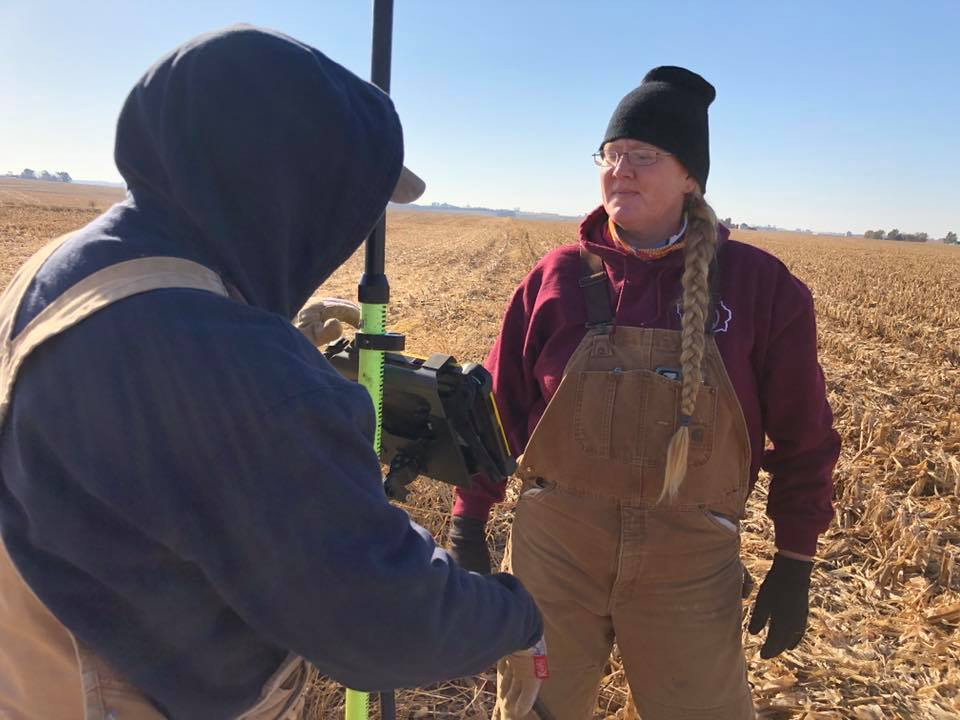 Janelle and Meleia survey a field for Mahaska SWCD.