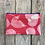 Thumbnail: Long Double Zipper Pouch in Red with Salmonberry Leaf Design