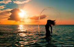 Kat-Sunset-Hair-Flip.png