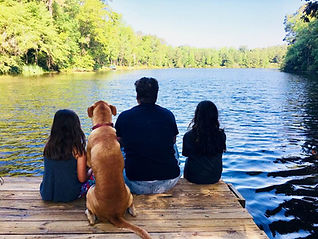 ryan and kids and buddy on dock.jpg