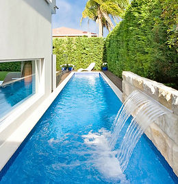 Residential lap pool, in-ground pool with water feature