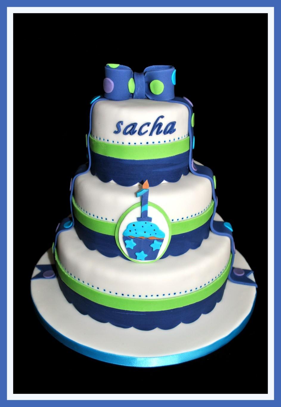 Gâteau première bougie en bleu et ve