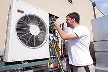 HVAC technician working on a mini-split condensing unit