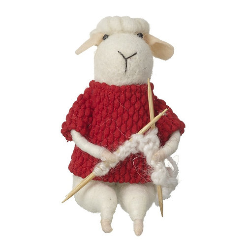 Just a sheep sitting doing some knitting.