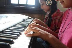 \students playing a keyboard