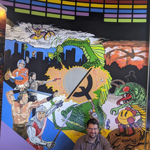Our Mural with Artist, Travis