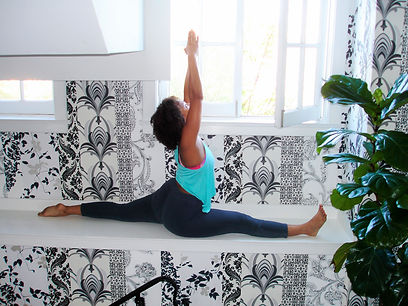 Hanumanasana, splits pose. Photo credit: Kumi Yogini at The Culver Hotel