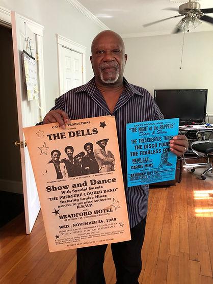 1 Mel Davis with posters.jpg