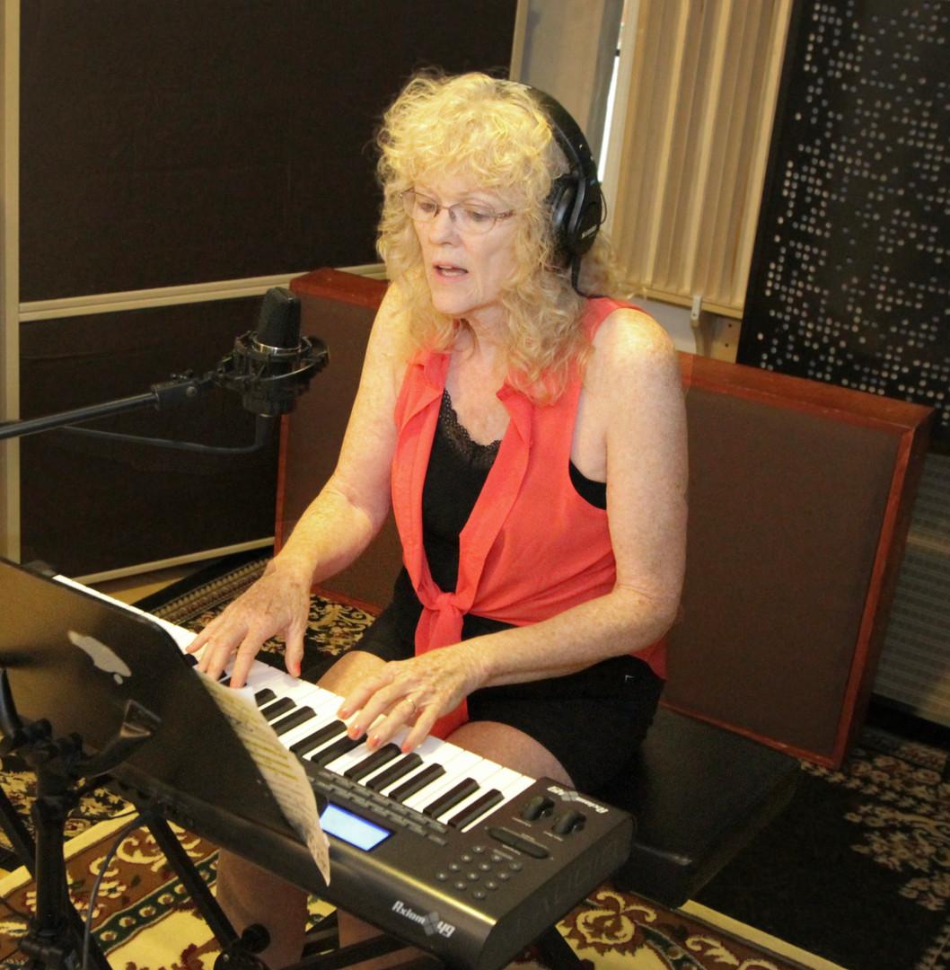 Sheri tracking keys and vocals