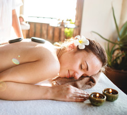 woman-in-massage-therapy-with-stones-on-