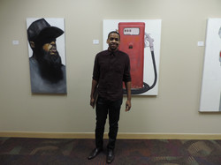 Artist Riley Holloway with his work.