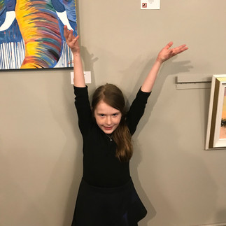 Someone is proud of her Mom's artwork
