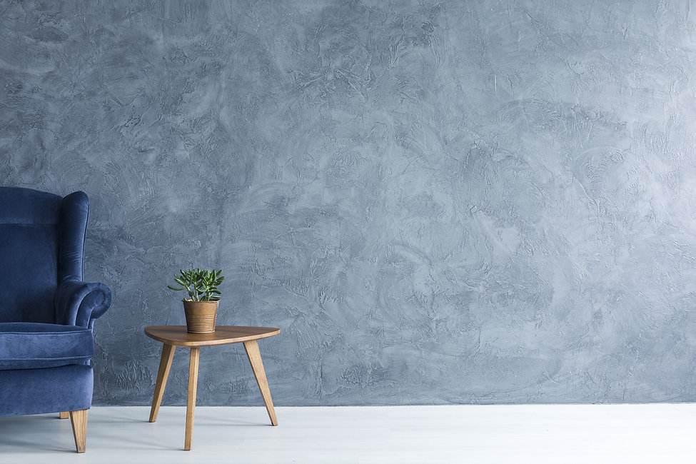Interior with grey wall blue armchair an