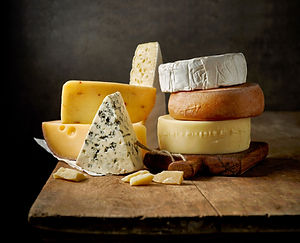 various types of cheese on rustic wooden