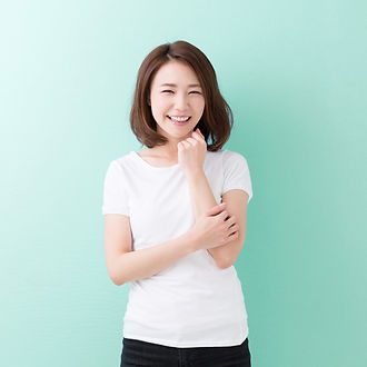 Asian Woman Smile with Light Green Backg