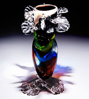 Multi color leg vase with hand leaves, blown glass made with Wilson High school students 2017