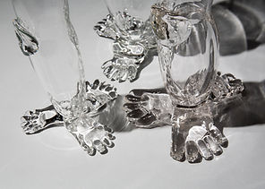 detail of feet on leg vases, clear blown glass
