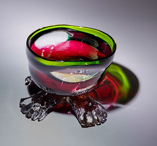 Multi color bowl with 4 feet, blown glass made with Wilson High School students 2017