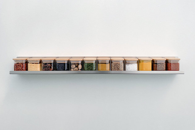 Arcus12 - Stainless Steel floating spice shelf with 12 glass jars, straight on view