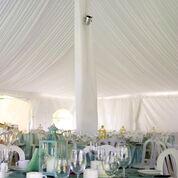 Pole tent draped