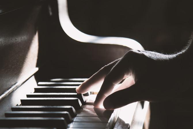 Ron takes a piano lesson!