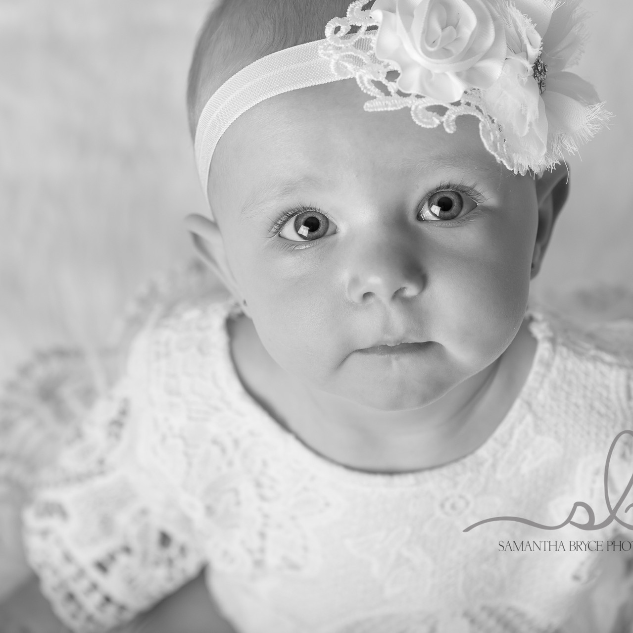 close up baby girl black and white