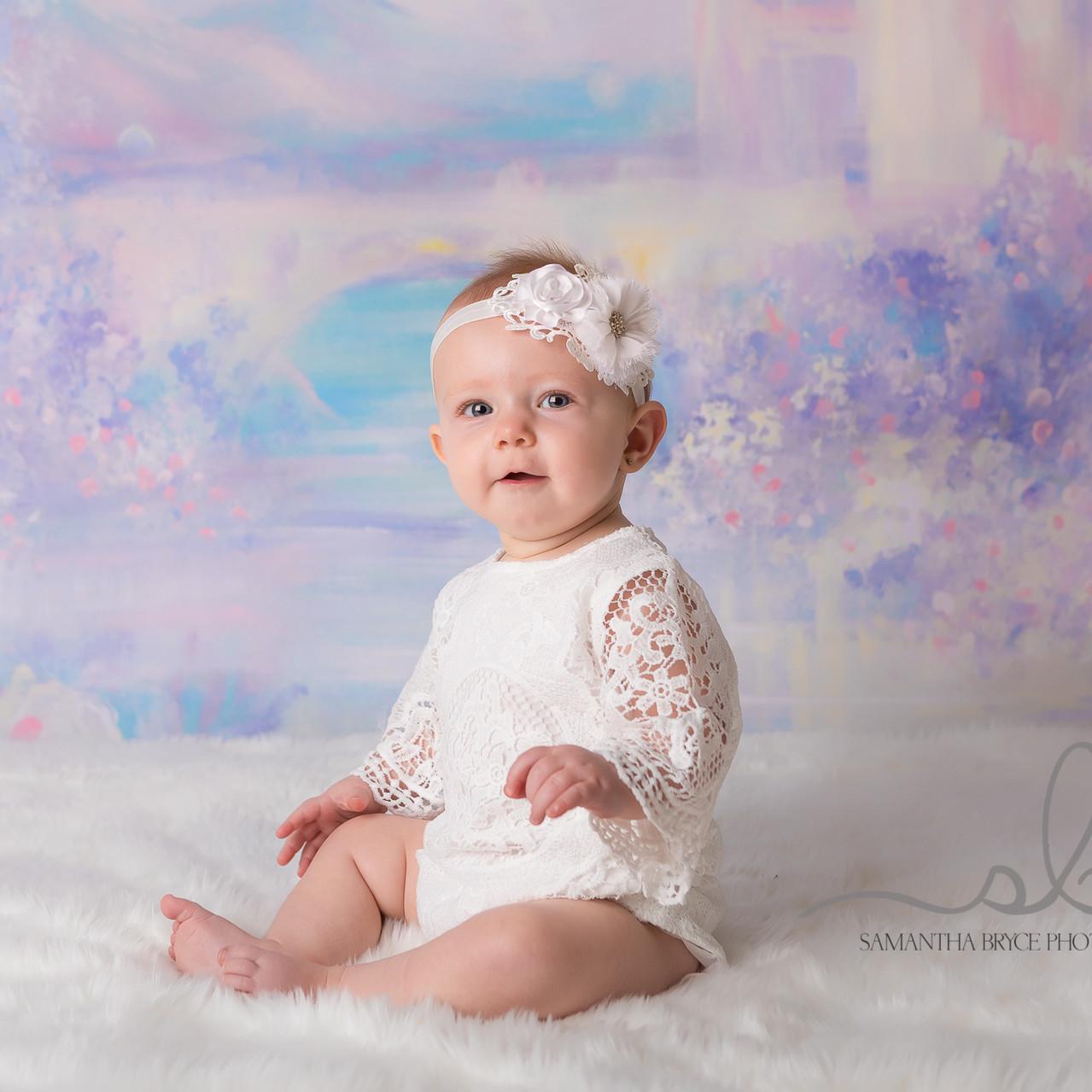 baby girl sitting princess backdrop