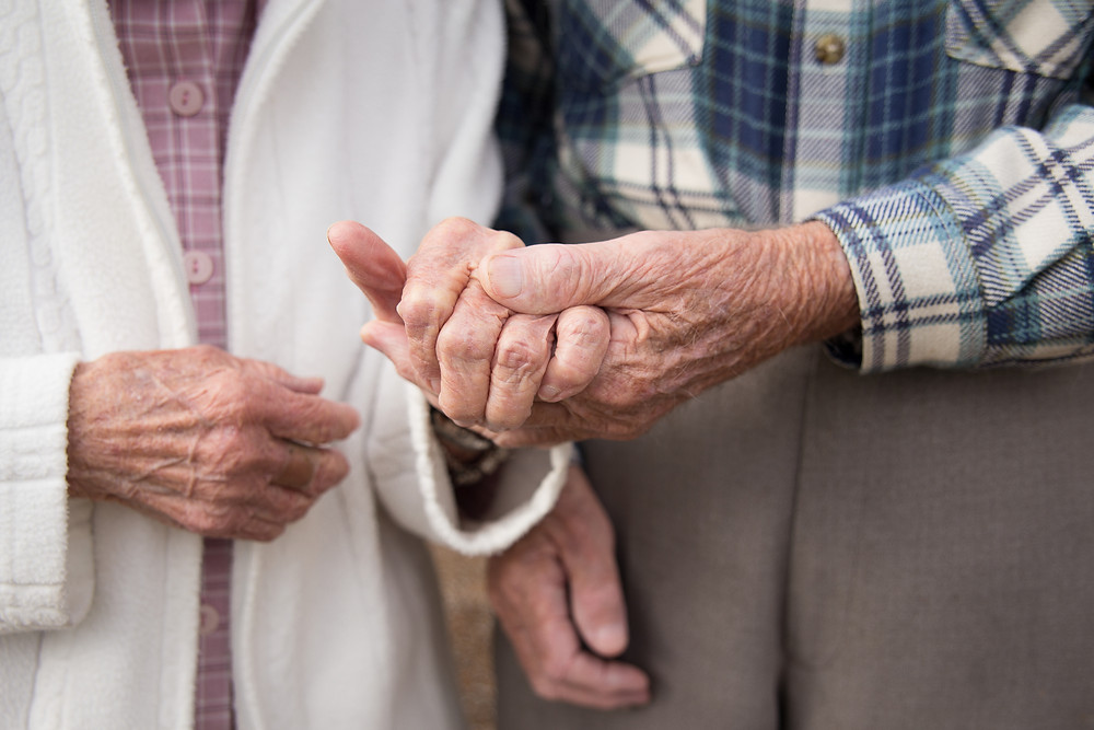 Elderly Husband and Wife holding hands